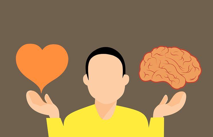 Zeichnung eines Mannes, auf einer Seite von ihm ein Herz, auf der anderen ein Gehirn