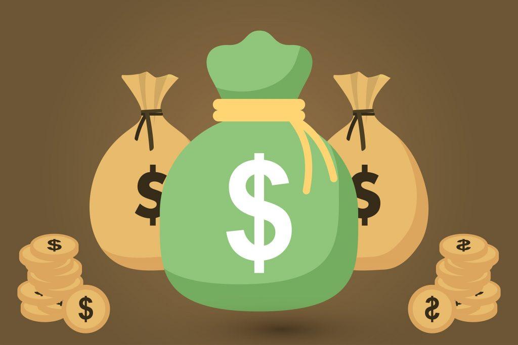 Drei Säcke mit Dollarzeichen, darum liegen Münzen.
